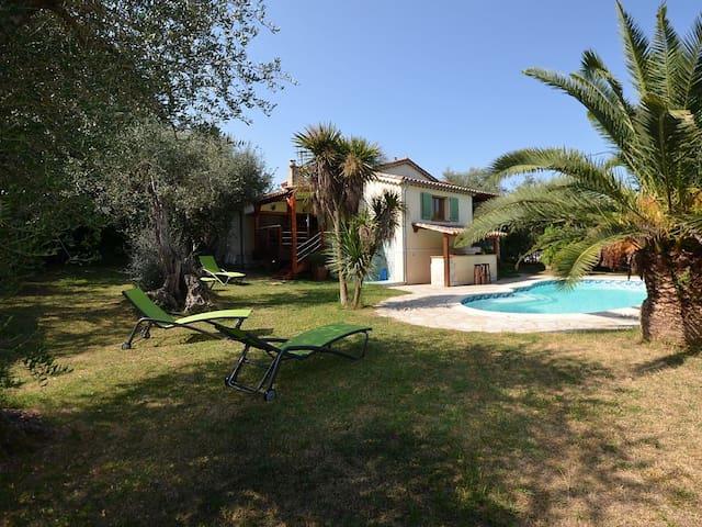 Apartment in villa, garden and private pool.