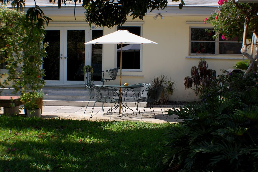 Patio with grill, umbrella and iron French outdoor furniture