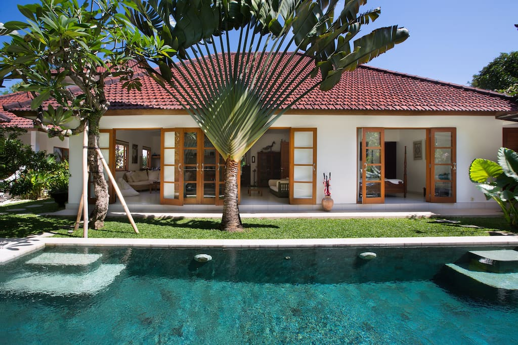 Pool and tropical garden, with view into main villa.