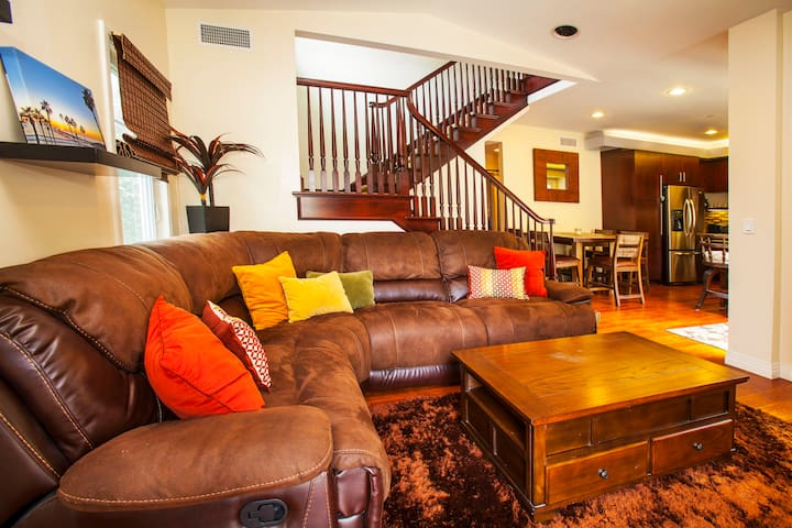 Large sectional sofa with dual recliners. Head upstairs to the master retreat