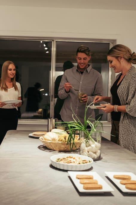 Guests tasting fresh ingredients.