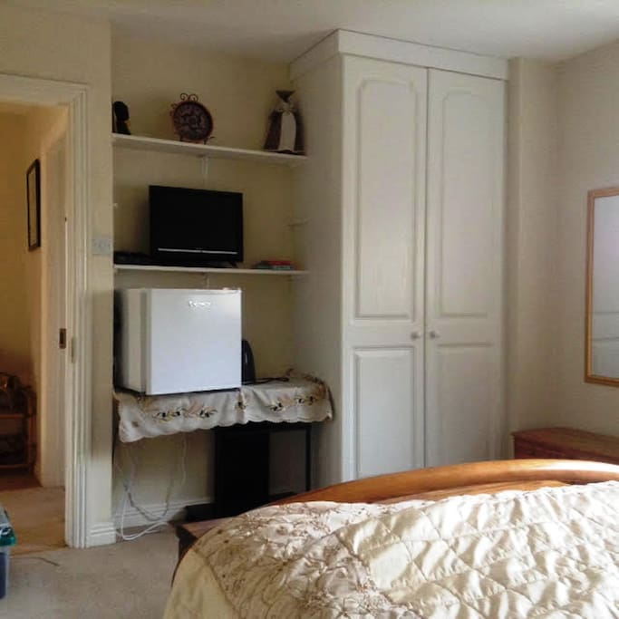 Double room, TV and fridge