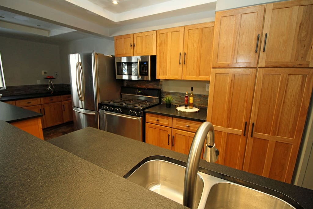 New kitchen with commercial grade appliances and granite counters