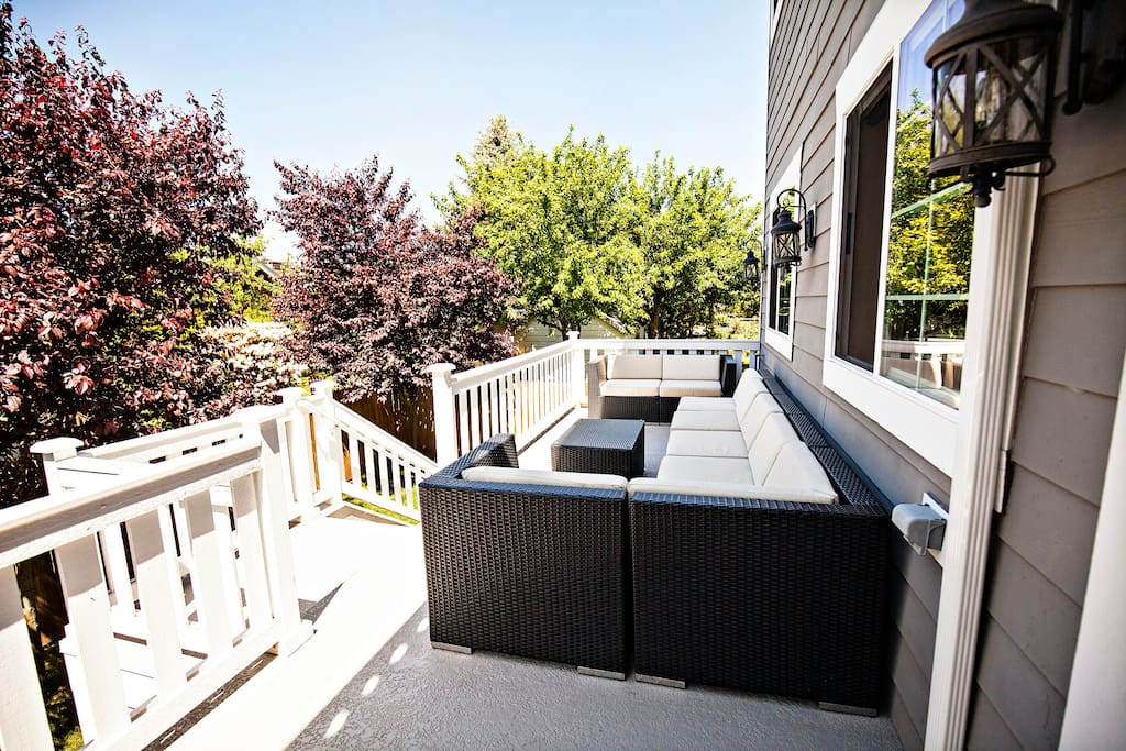 Back deck located off open concept family/kitchen with awesome seating area for 6-8! Deck area also includes an umbrella (not pictured)