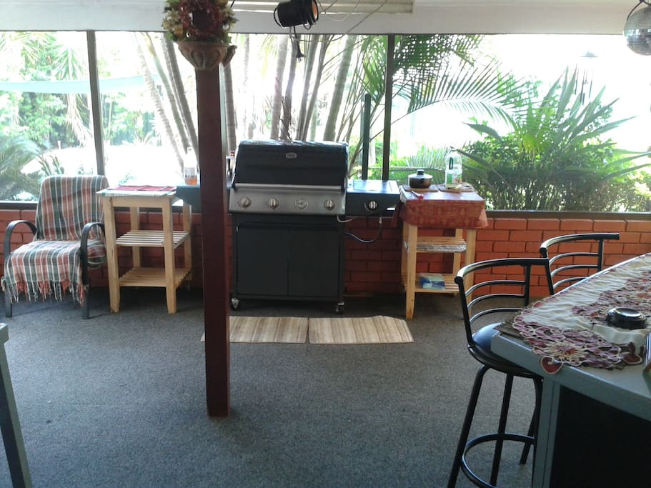 Screened in outdoor area to cook and eat on warm nights.