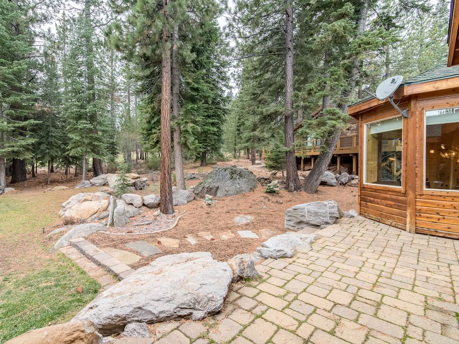 Surrounded by pines, this exceptional home sits on the 8th fairway of the Tahoe Donner Golf Course.
