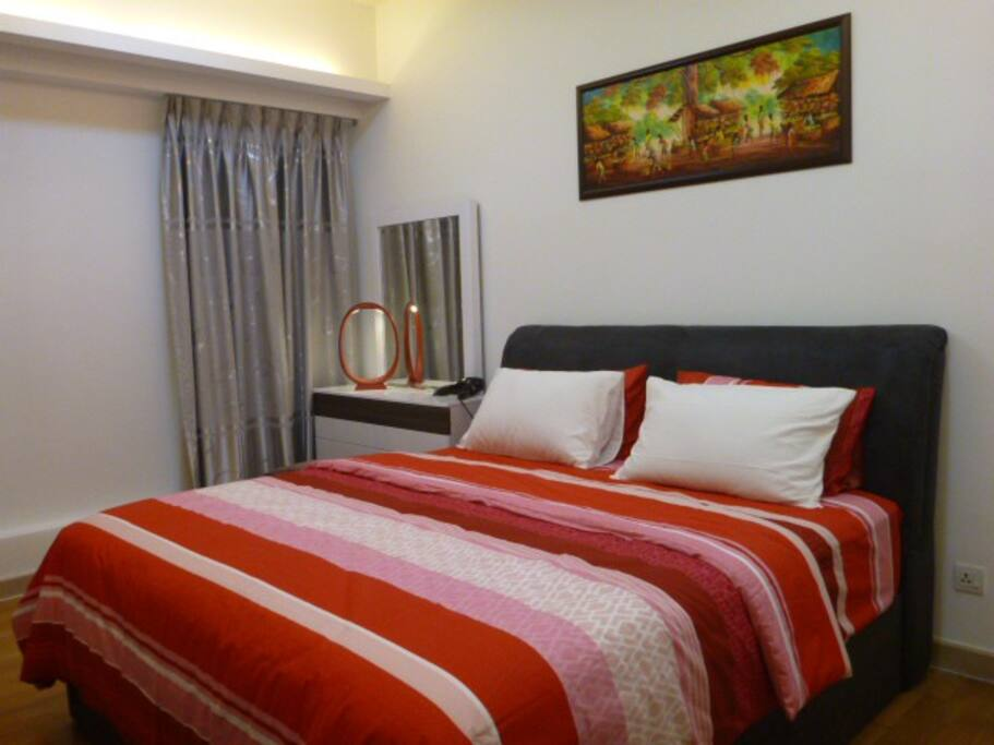 Bedroom with king sized bed, international wall plug & hair dryer