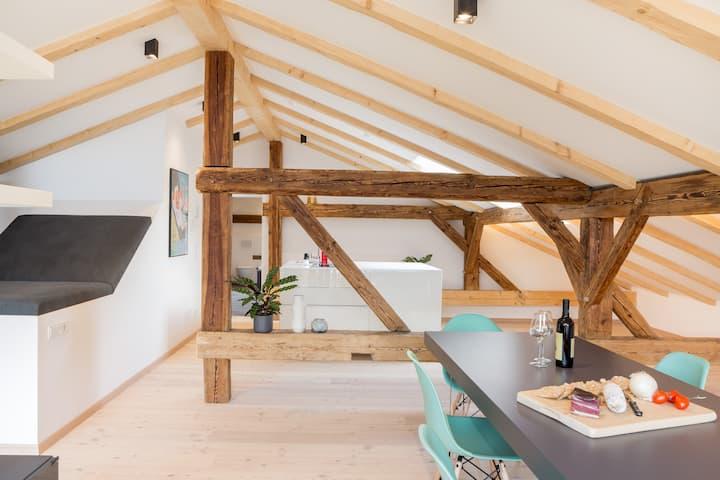 Spacious design loft in a historic farmhouse