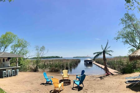 Pelican Lake Guest Cabin Beach Bar Dock Palm Tree