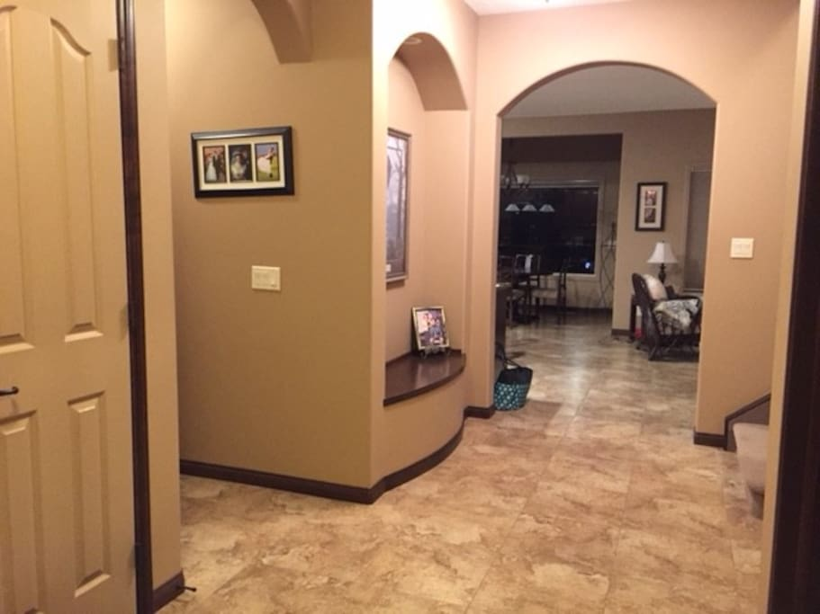 Spacious foyer with large tile throughout main floor