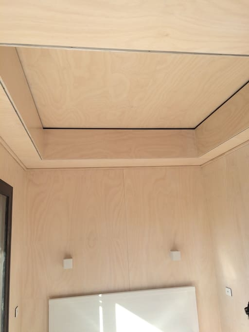 Sleep under the stars or close the roof (built in rain sensor)