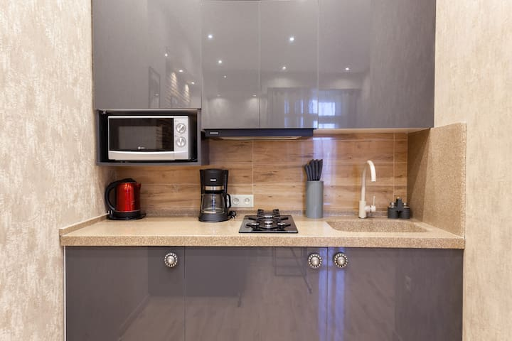 A well equipped kitchen with all one needs for a short to medium term stay. Please note that we also a washing machine under the kitchen counter, for your maximum comfort.
