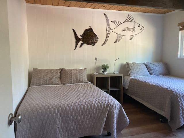 Bedroom #3 Floundering Fish Room with two double beds is perfect for friends to share and also makes a great kids room. This room includes a DVD/VHS player (Adult and Kid DVD and VHS tapes provided).