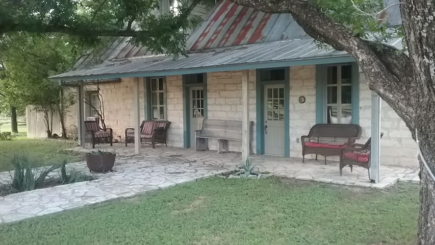 Charming two bedroom, two story Old German Style Rock Cottage set on The Done Strange Ranch just a 15 minute drive to Boerne or Comfort, Tx.