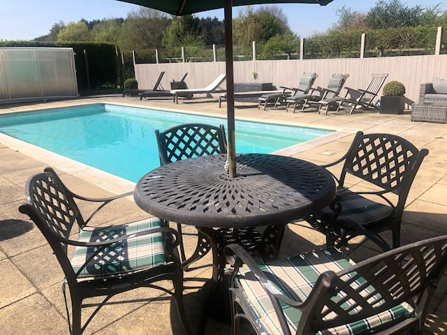 Swimming pool with seating areas and sun loungers