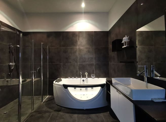 Master bedroom ensuite. With a spa massage bath and double shower shower case. Also two separate sinks in this ensuite and toilet as well.   Luxury lifestyles
