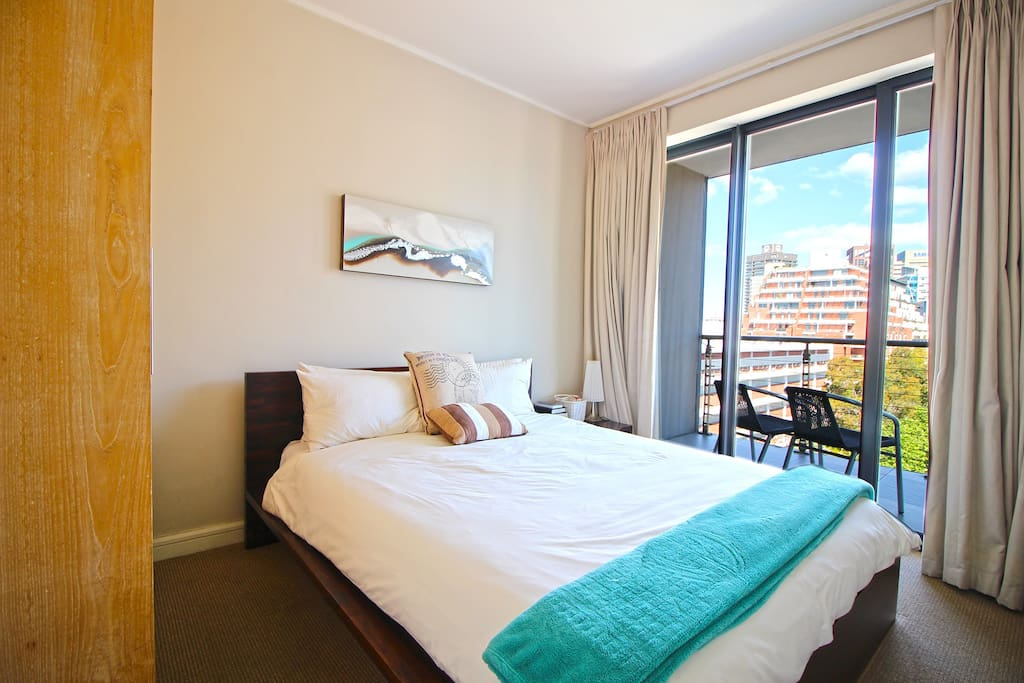 One bedroom with comfortable queen bed, opening on to balcony with great views