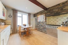 A homely and spacious family kitchen with dining area