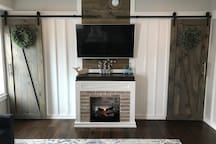 Electric Fireplace, 55inch LED Smart TV and sliding barn doors