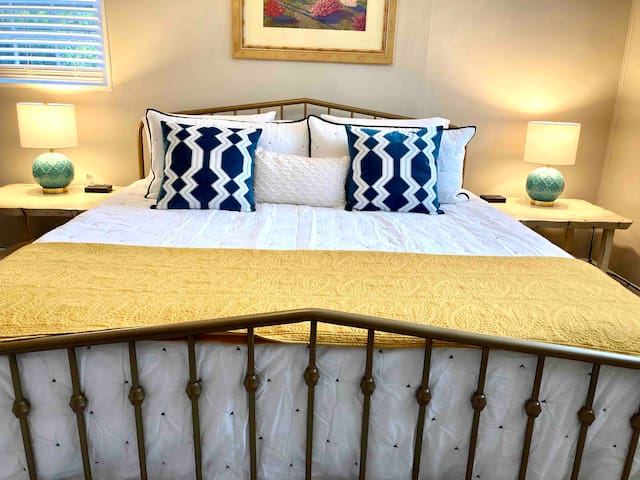 Very comfortable new king size memory foam mattress with extra pillows for a great night sleep