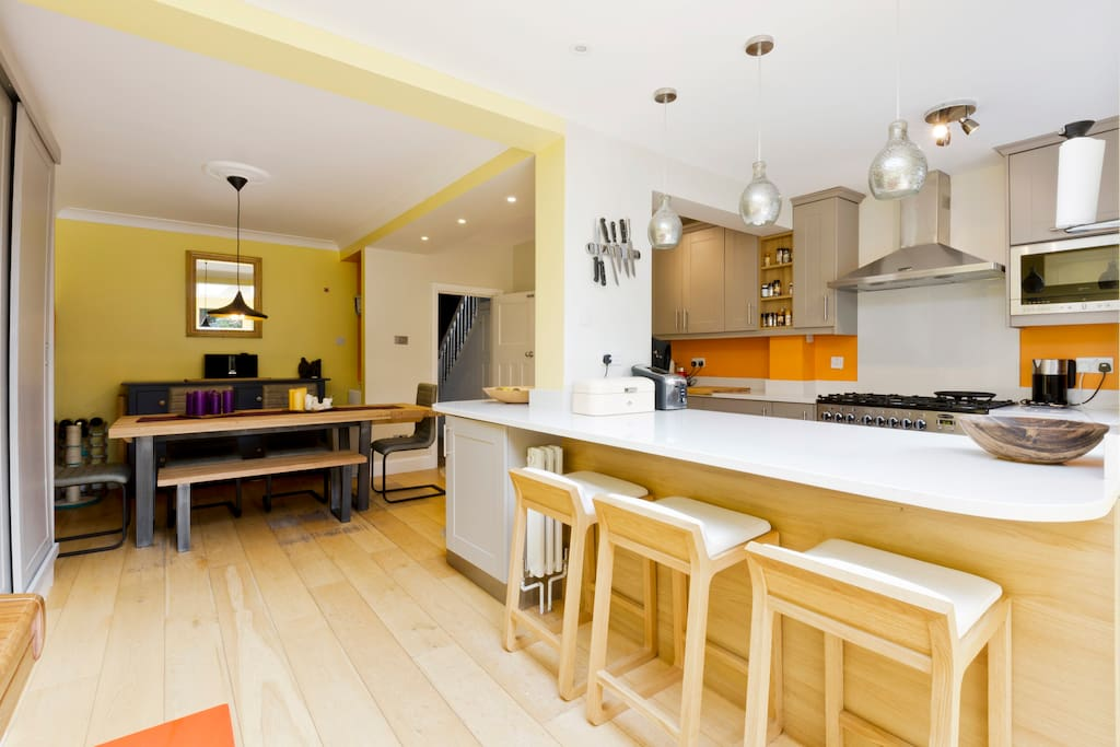 Kitchen with dining area and large doors onto garden