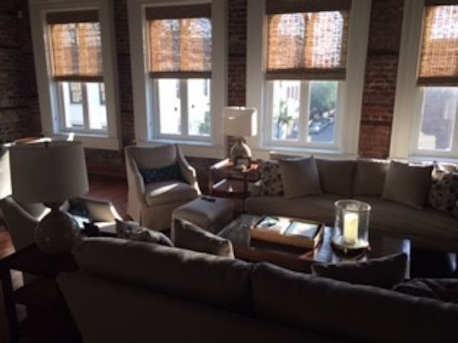 Open living area with big windows overlooking King St.