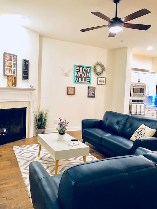 This modern living room which is open to the kitchen. Its the perfect place to wind town after a long day of touring Nashville. This is a public space.
