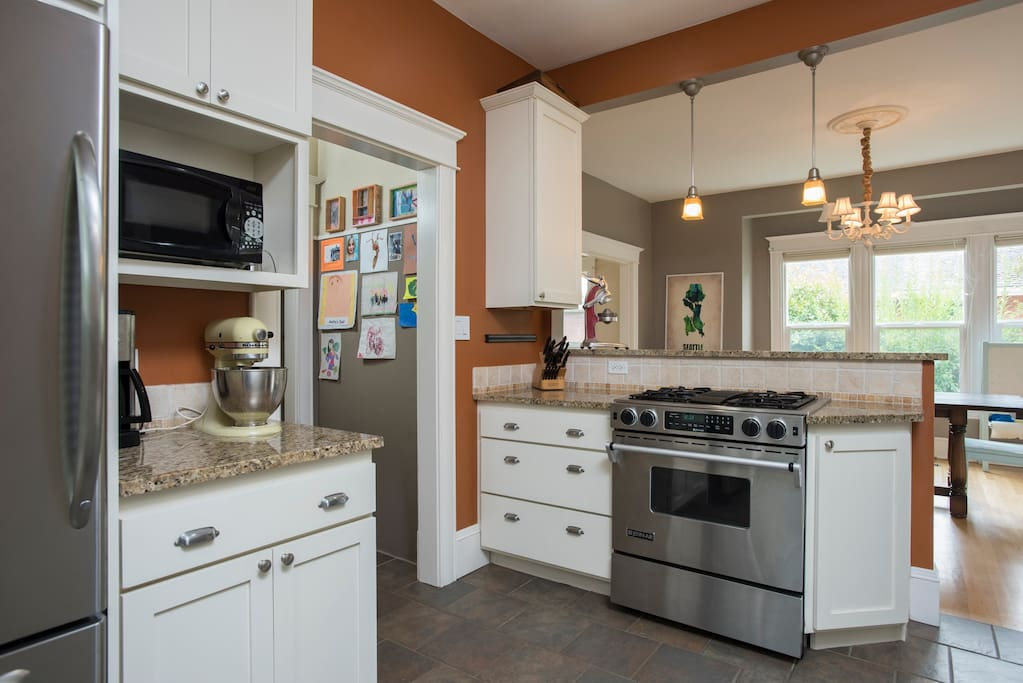 Large kitchen with ample cookware and a gas stove