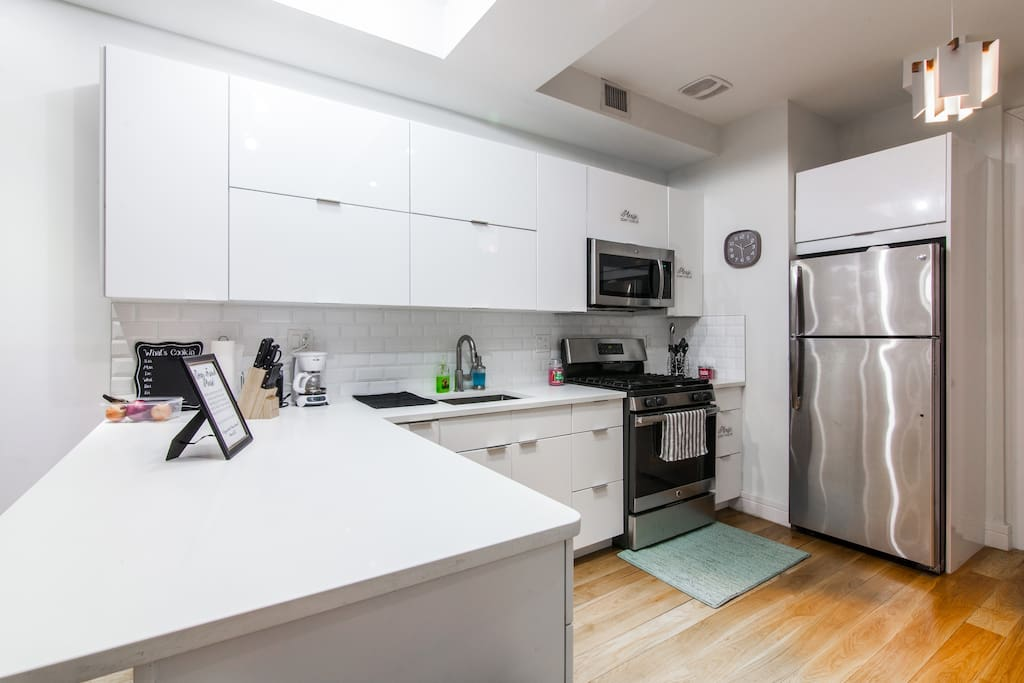 Brand-new kitchen with hardwood floors, cabinets, and microwave