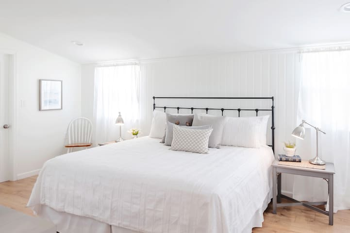 Super comfortable King size bed with cotton linens.