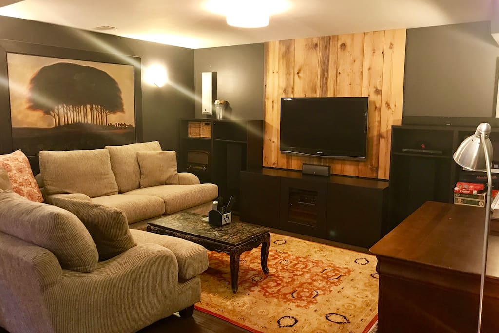 Living Room/TV area with very deep, soft couches.