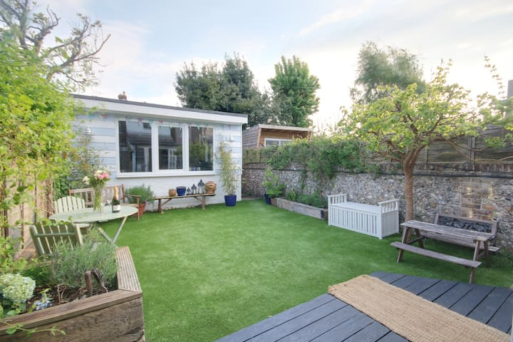 Garden (showing 'The Studio' annex with double bed, piano, media centre, large 65inch TV etc)