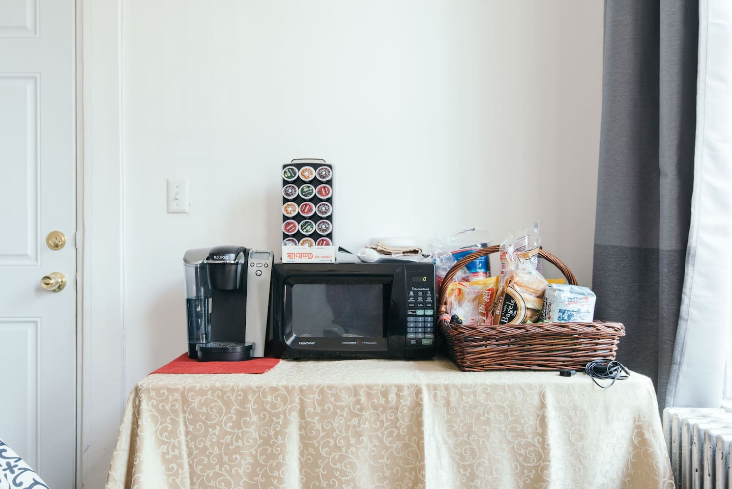 Keurig coffee maker with a variety of coffees available to you as well as different teas, oatmeal, and bagels.  A microwave to cook/warm things up