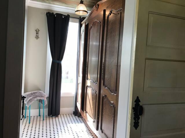 Master bathroom hallway with large wardrobe for closet