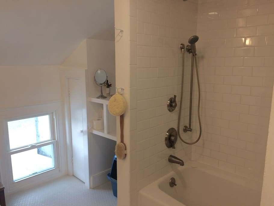The newly renovated bath--spacious, pristine, all white and bright (much more so than in photo)