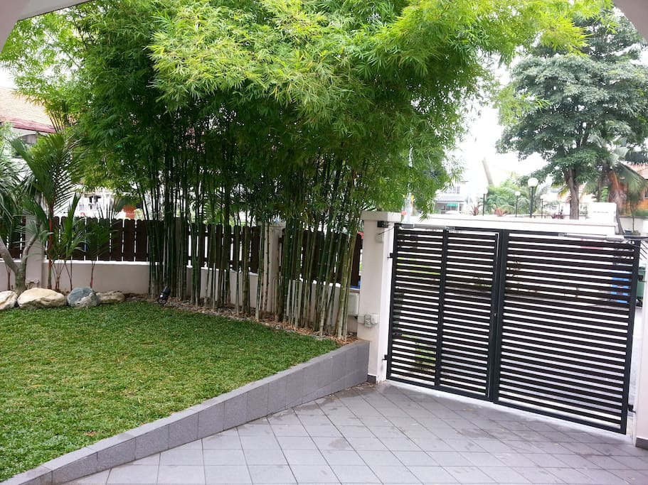 Frontal gate of the property with bamboo cover.