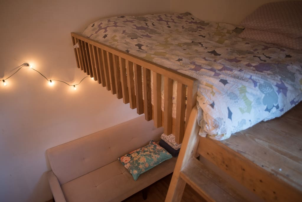 Two queen size beds, the one in the loft is a traditional mattress and the one below is a futon.
