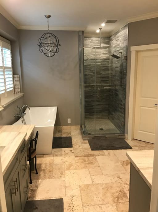 Master bathroom suite with double sinks, freestanding tub, 3 raining shower heads and a shower wand.