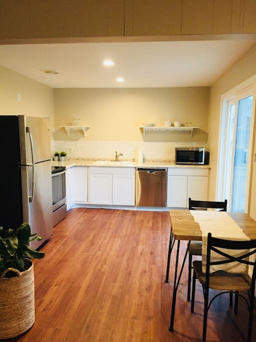 Bright and sunny kitchen with new appliances and flooring.