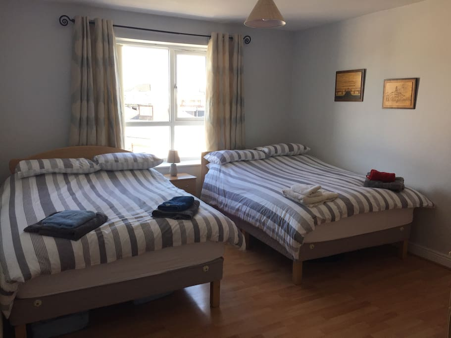 Main Bedroom with plenty of space and two double beds.