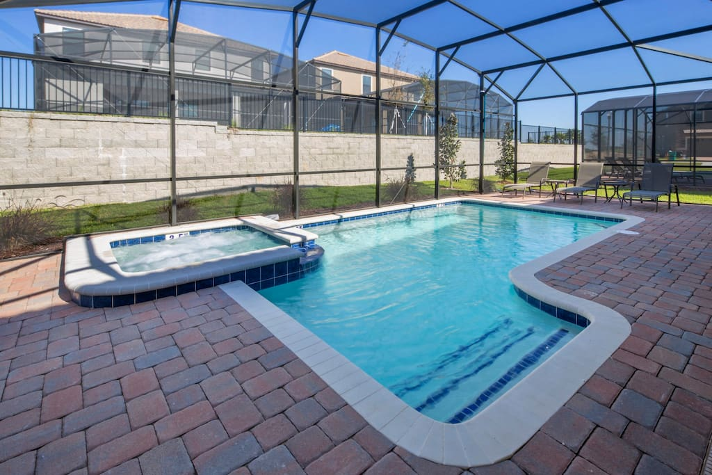 Make magical memories as a family when you stay in this beautiful ChampionsGate vacation home and play in and around this sparkling clear pool. The pool is fitted with a removable pool safety fence for your peace of mind.