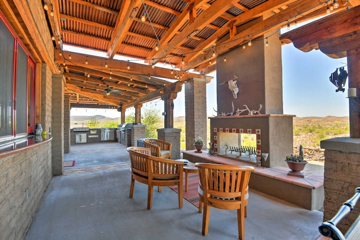 Warm up with the outdoor fireplace as your relax under the hanging lights.
