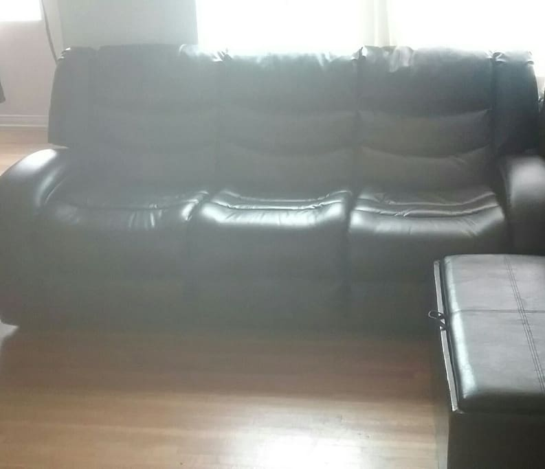 Full length leather reclining couch