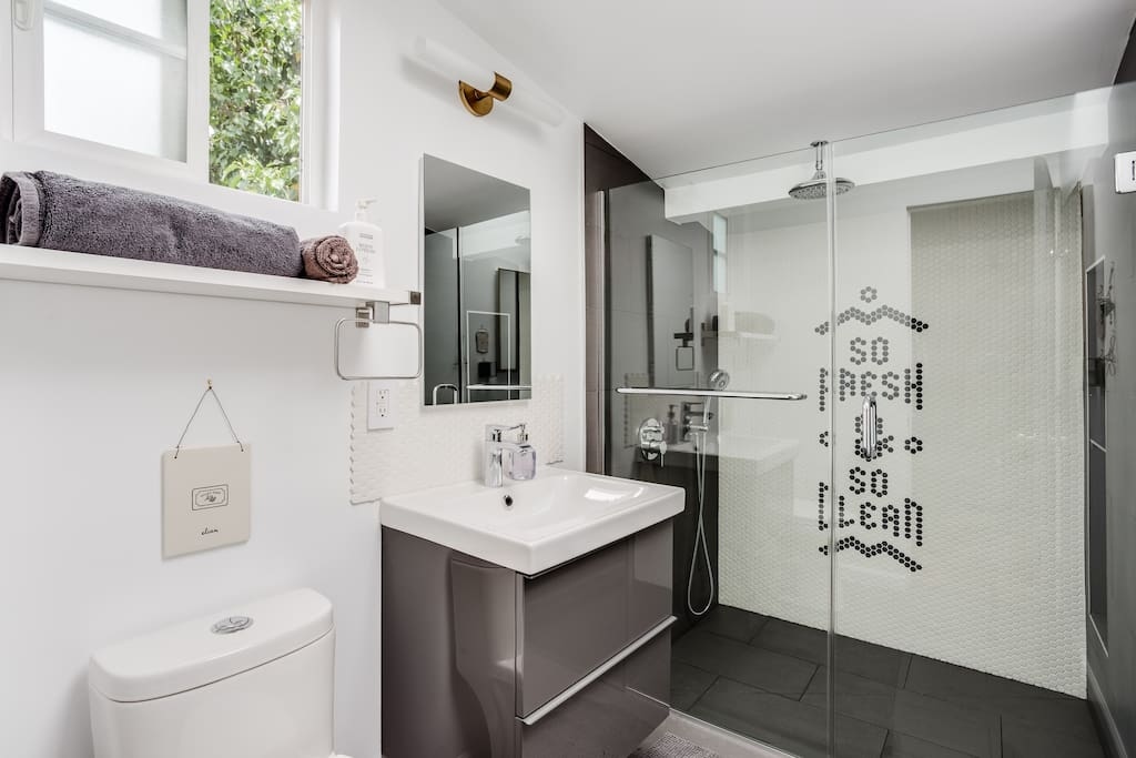 Spacious spa bathroom, shower of your dreams features rain shower head and handheld