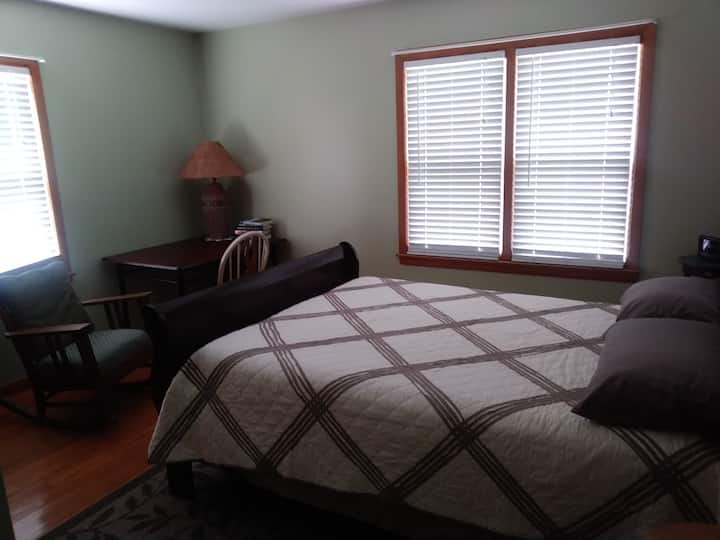 Spacious bedroom with queen size bed