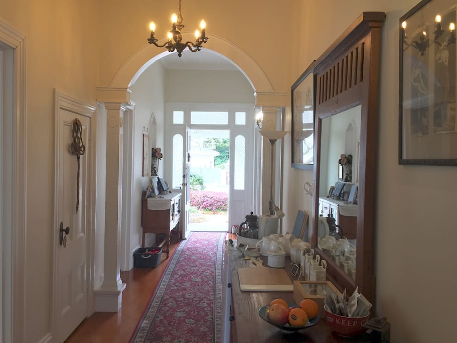 Chelsea House hallway with many ornate features in this 100+yr old home