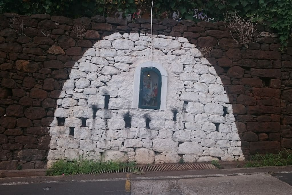 Landmark of Santinha in the Wall on main road in front of house