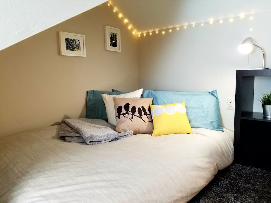 """Upstairs loft bedroom area (Please note: maximum height of roofline is approx 5'5"""" tall...many angles!!)"""