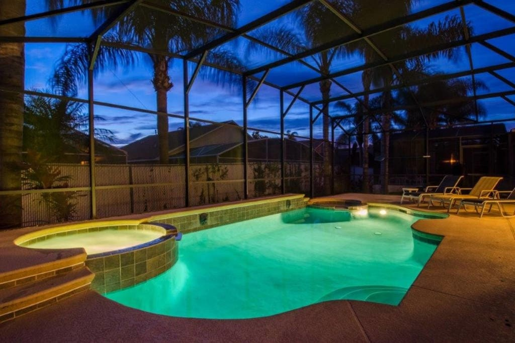 Pool lights up at night with Jacuzzi spa and baby pool