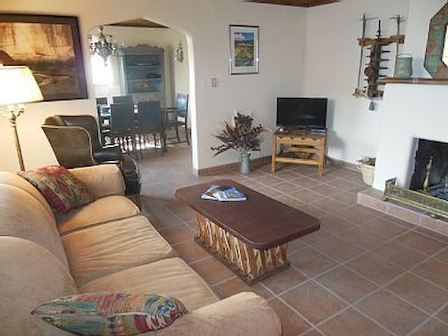 Living room.  Seating for six. SW tiled floors throughout.